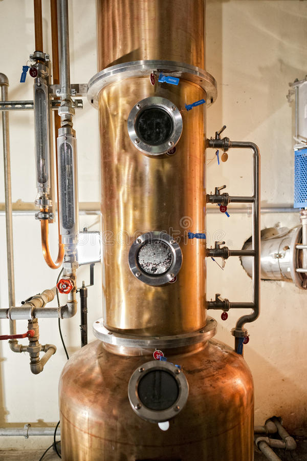 Copper still alembic inside distillery. To distill grapes and produce spirits royalty free stock photos