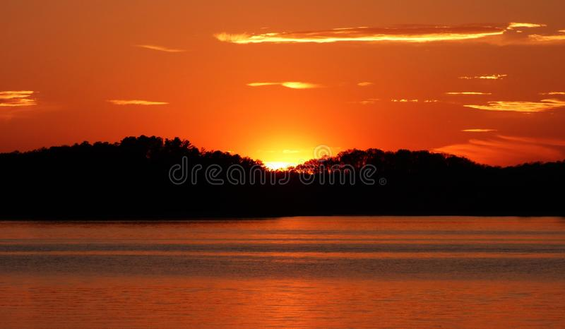Copper tone and Golden Georgia Sunset on Lake Lanier royalty free stock photo