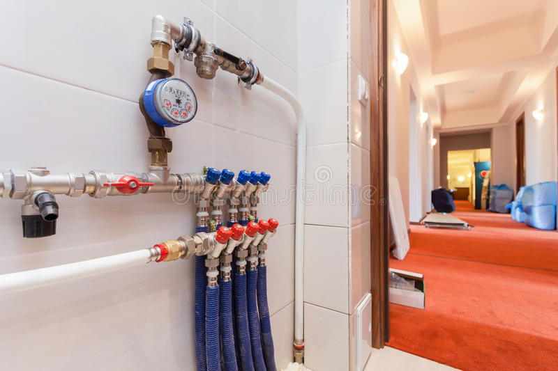 Copper valves, stainless ball valves, detector of water and plastic pipes of central heating system and water pipes. In the boiler room equipment in apartment royalty free stock photos