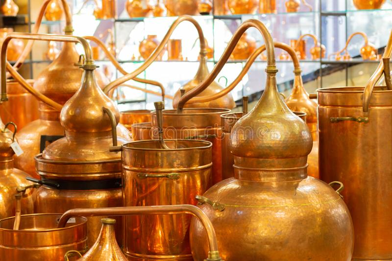 Copper ware, serpentine and jugs on the shop window in the store. stock photos