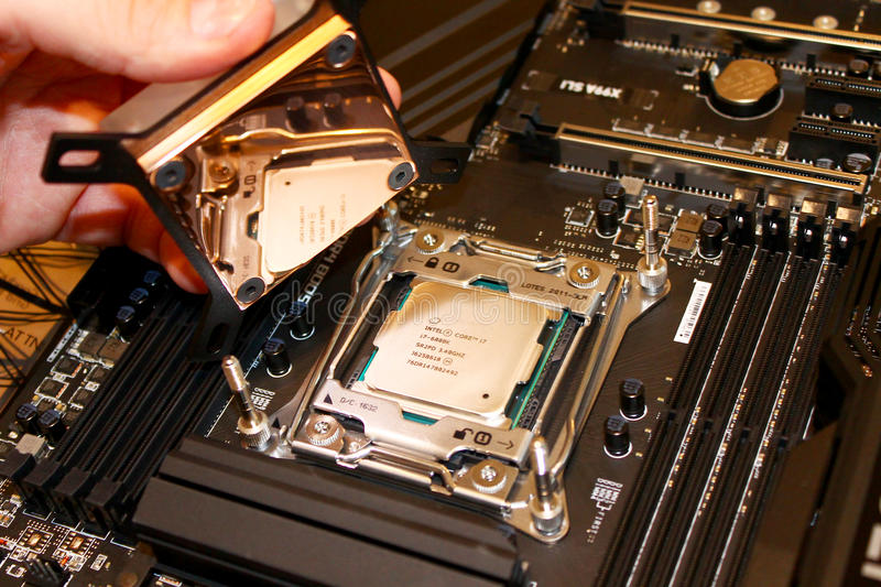 Copper water block install over CPU stock photo