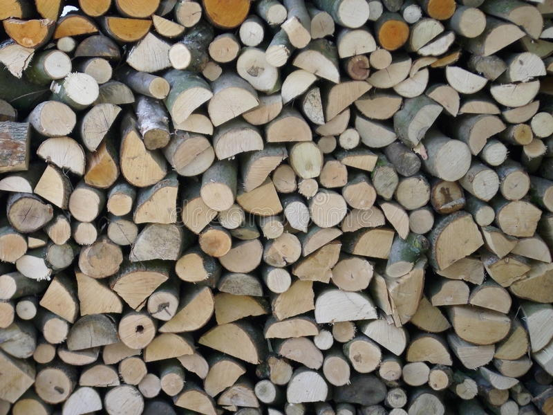 Firewood log stack. Split logs drying in a stack and making an attractive collage of interlocked cut log ends. Could be used as a background texture royalty free stock image