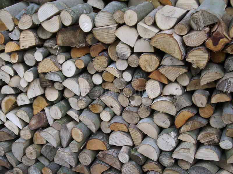 Firewood log stack. Split logs drying in a stack and making an attractive collage of interlocked cut log ends. Could be used as a background texture stock photography