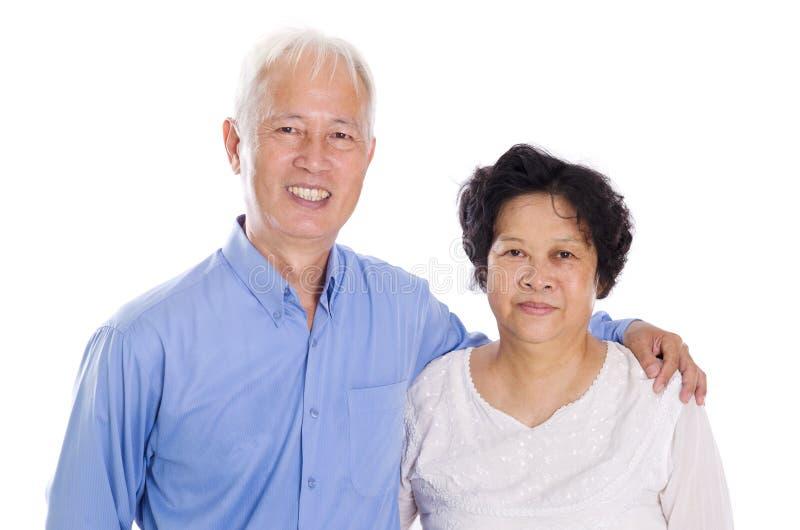 Coppie anziane asiatiche isolate fotografia stock libera da diritti