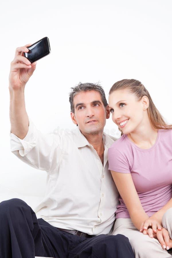 Coppie che prendono autoritratto fotografia stock libera da diritti