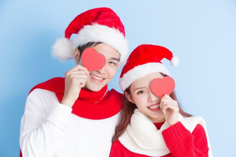 Coppie con il Buon Natale immagini stock