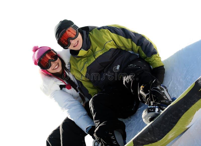 Coppie degli snowboarders felici fotografia stock libera da diritti