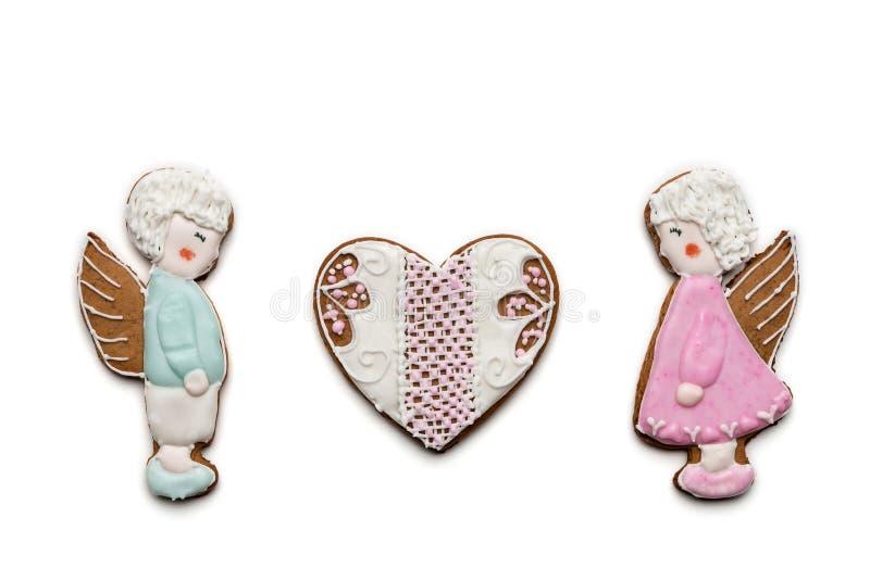 Coppie dei biscotti degli angeli e del cuore immagine stock libera da diritti