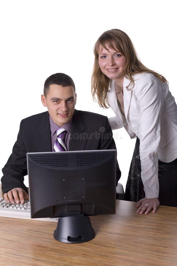 Coppie di affari alla scrivania immagine stock libera da diritti