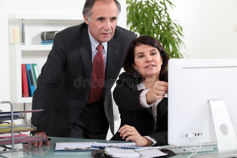 Coppie di affari maturi immagine stock