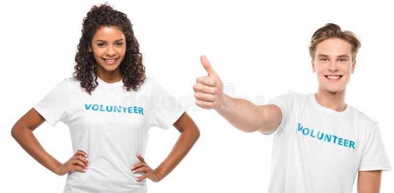 Coppie di giovani volontari immagini stock libere da diritti