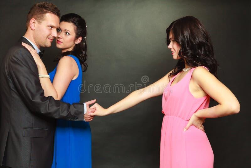 Coppie ed il suo amante geloso della donna fotografia stock libera da diritti