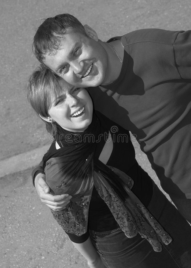 Download Coppie felici sorridenti immagine stock. Immagine di università - 209941