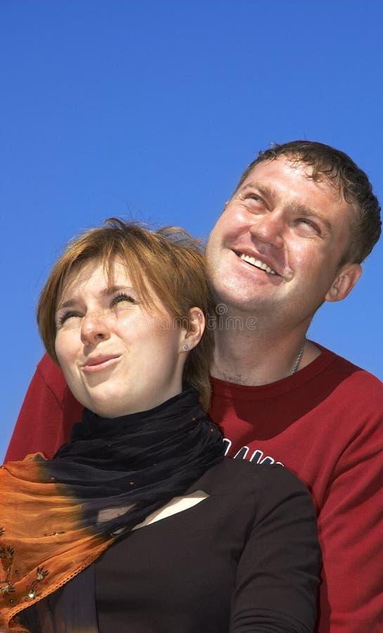 Download Coppie felici sorridenti fotografia stock. Immagine di sussidi - 209950