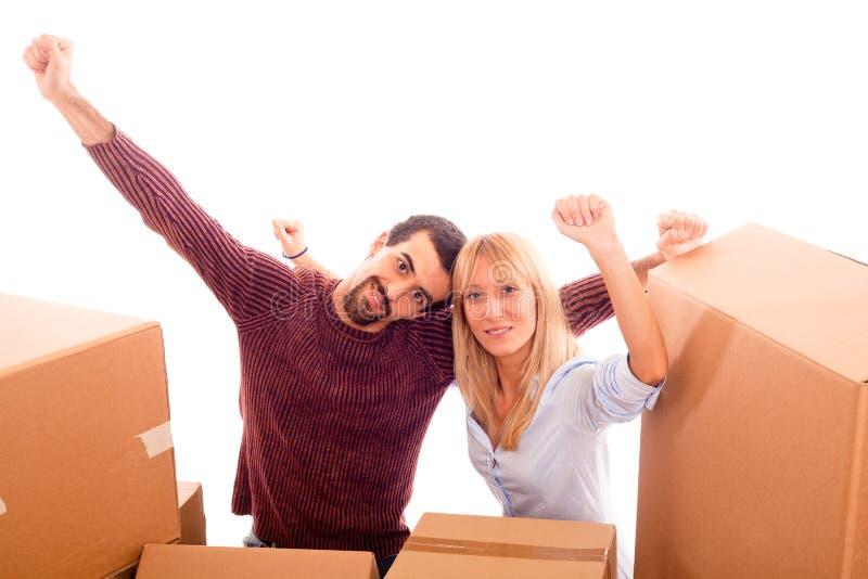 Coppie felici sul muoversi immagine stock libera da diritti