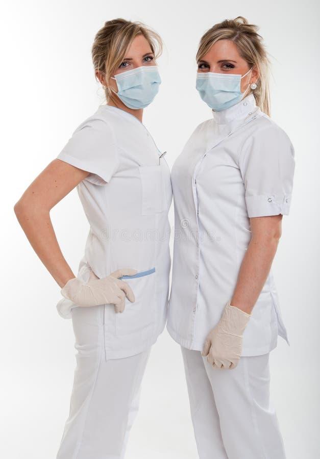 Coppie i professionisti del settore medico-sanitario femminili immagini stock