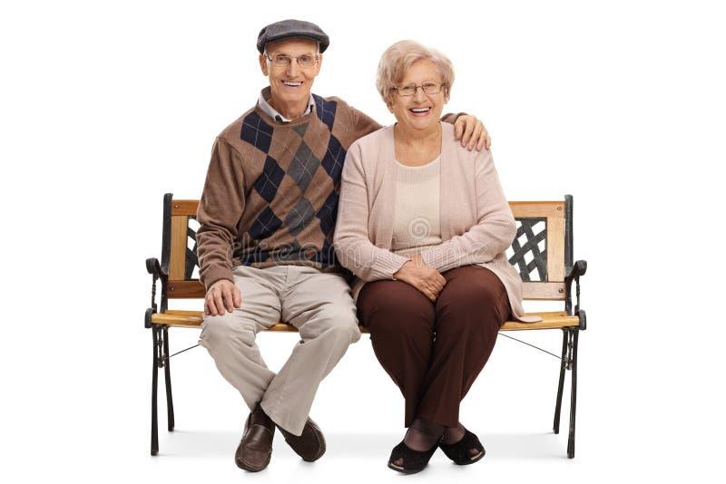 Coppie mature che si siedono su un banco immagine stock