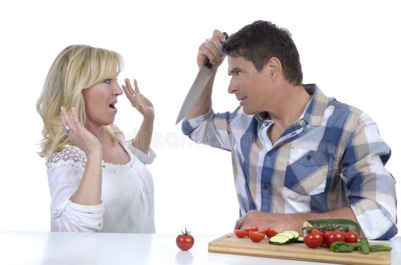 Coppie mature nella disputa coniugale seria immagine stock