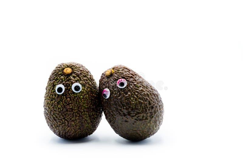 Coppie romantiche degli avocado con gli occhi googly fotografia stock libera da diritti