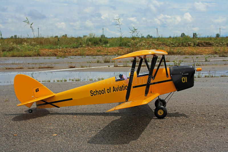A copy of the English model Tiger moth plane. Tiger moth (eng. Tiger Moth biplane of 1930, designed by an English firm . Served as primary training aircraft with royalty free stock images