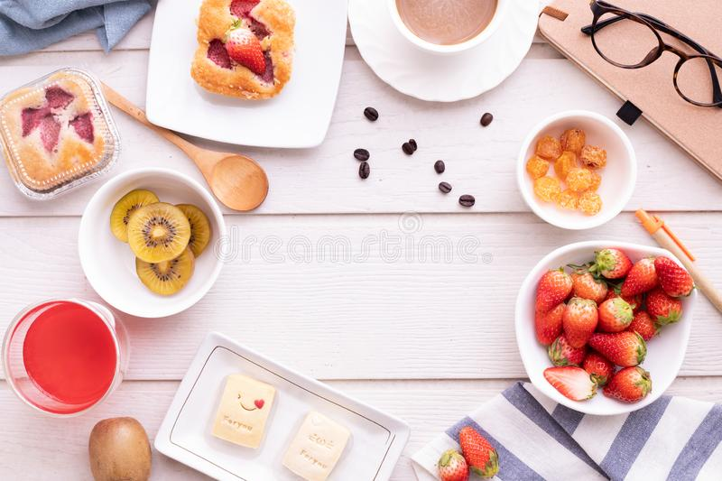 Copy space frame on breakfast table, top view table, sweet dessert royalty free stock photos
