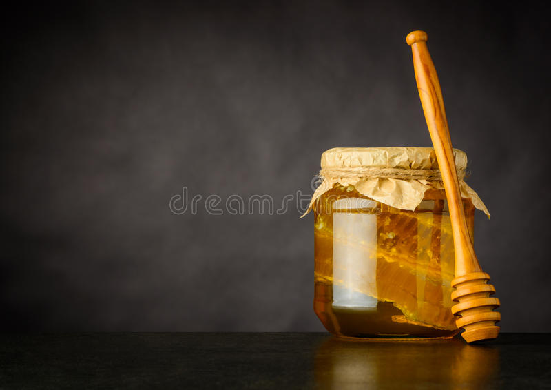 Copy Space of Honey Jar with Dripper. Honey Jar with Dripper, Comb and Copy Space royalty free stock photos