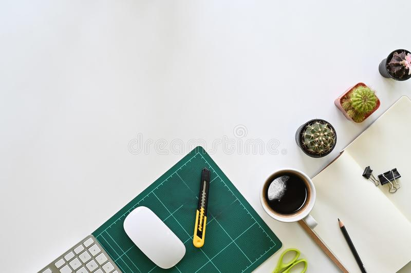 Copy space office desk office supplies with coffee and cactus on top view workspace royalty free stock images