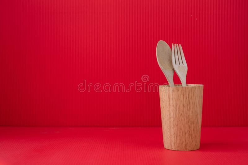 Copy space on Red Valentines background with Concept Couple Wooden spoon and fork stock image