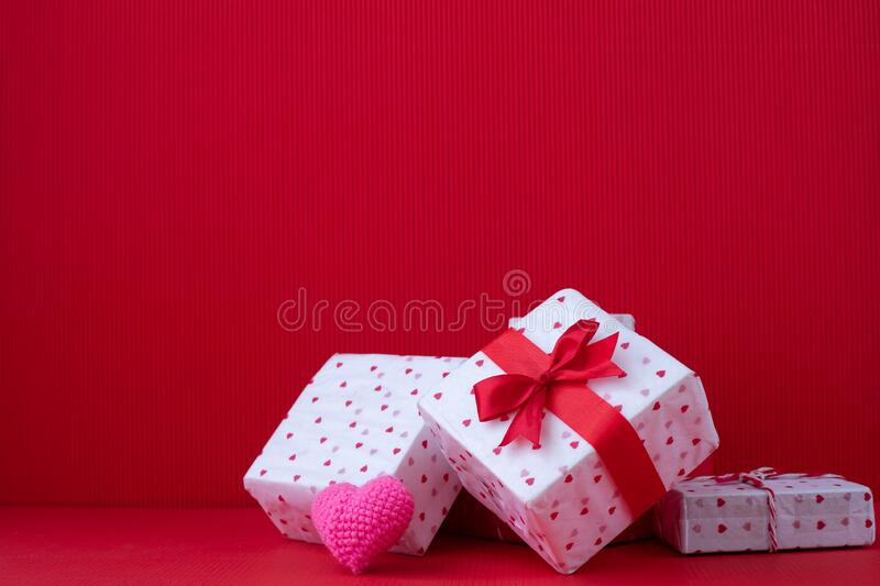 Copy space on Red Valentines background with Gift boxes and Pink heart shape toy stock photography
