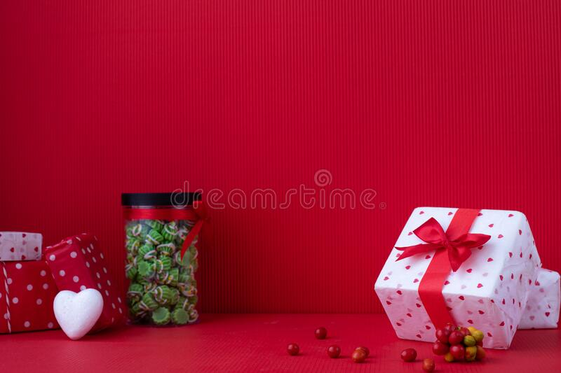 Copy space on Red Valentines background with Gift boxes stock photo