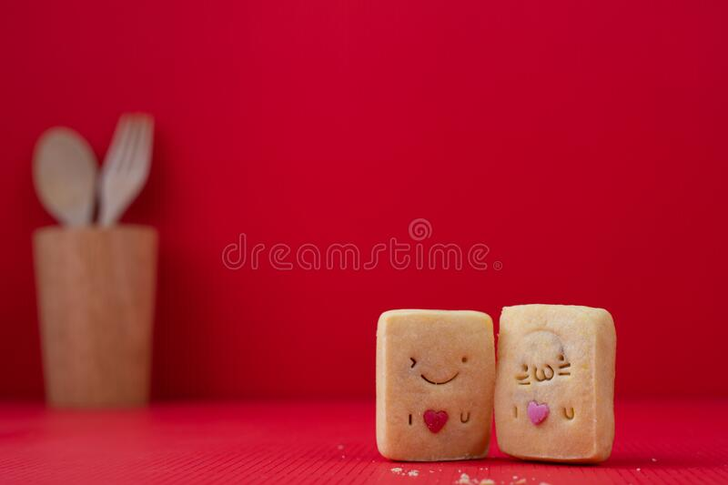 Copy space on Red Valentines background with Happy Couple Cookie royalty free stock photo