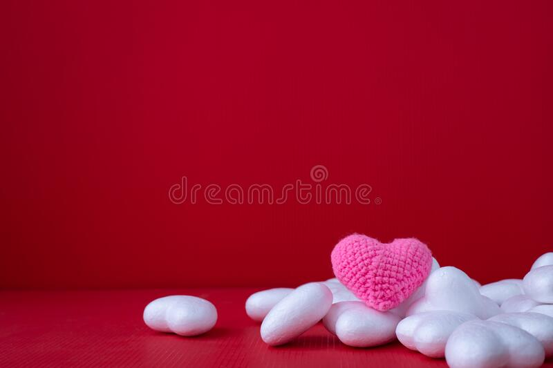 Copy space on Red Valentines background with Heart shape toy royalty free stock image