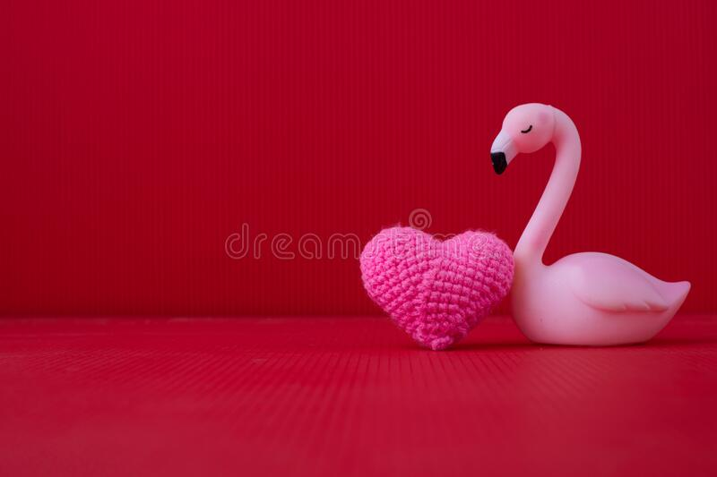 Copy space on Red Valentines background with Pink Alone bird toy royalty free stock photos