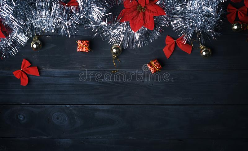 Copy Space. Silver Christmas Ornament on Black Wood Plank. Top V. Iew royalty free stock photography
