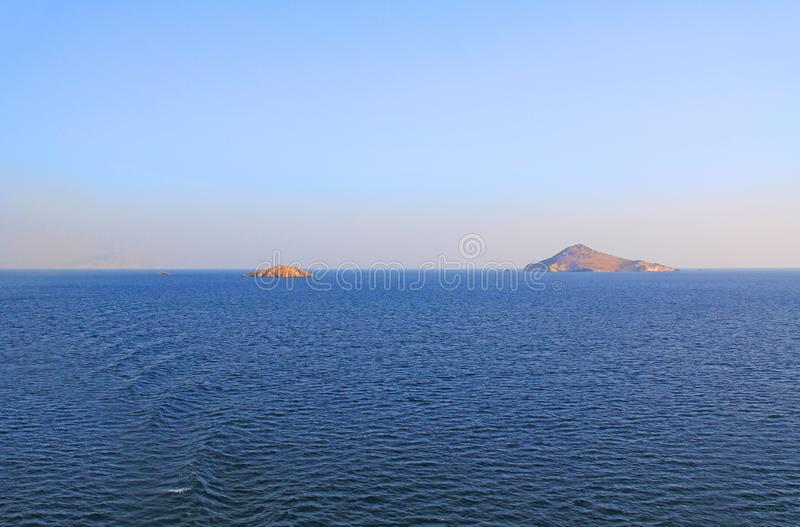 Copy Space of Water and Sky Background with Islands in Greece stock photography