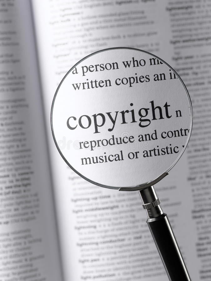 Copyright. Magnifying Glass Highlighting Copyright in dictionary royalty free stock image