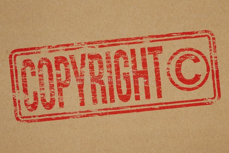 Copyright. Rubber stamp impression on brown paper background stock illustration
