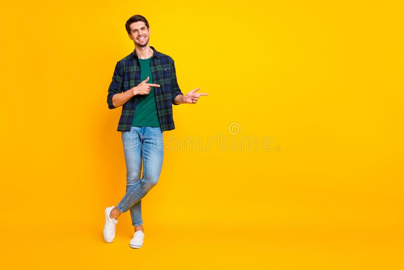 Copyspace full length body size photo of cheerful handsome guy wearing denim jeans checkered shirt footwear asking you. Copyspace full length body size photo of stock image