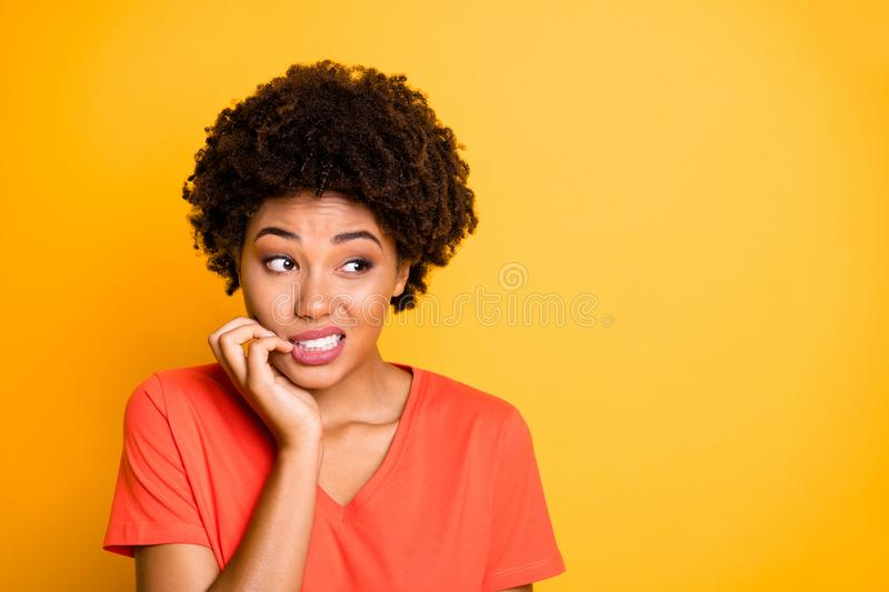 Copyspace photo of frightened afraid fearful woman biting her nails while observing terrible stuff going on wearing. Copyspace photo of frightened afraid fearful royalty free stock images