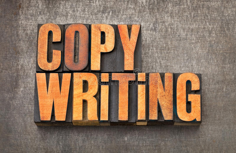 Copywriting word abstract in letterpress wood type. Copywriting word abstract - vintage letterpress wood type stained by red ink on a grunge metal background royalty free stock image