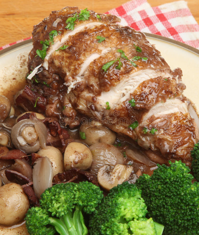 Coq au Vin. Chicken casseroled in red wine with bacon shallots and mushrooms stock photo