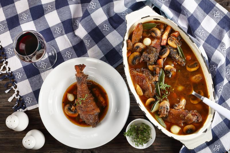 Coq au vin in a oval Dutch oven stock image