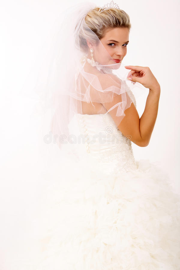 Coquette in wedlock. Portrait of pretty bride posing in isolation royalty free stock photo