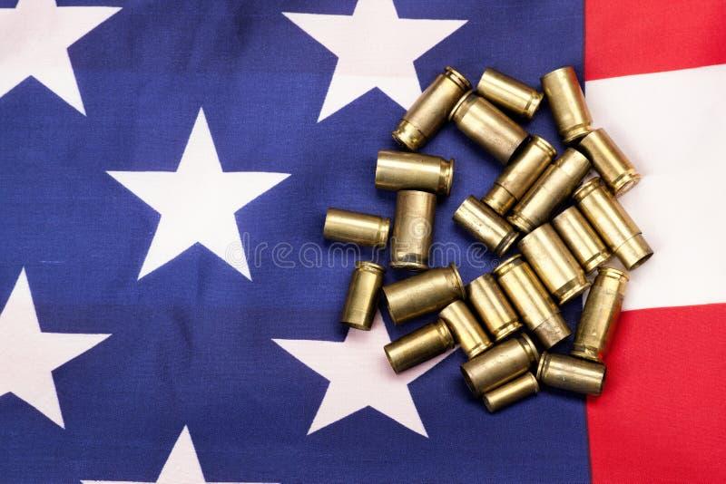 Coquilles sur le drapeau des USA photographie stock