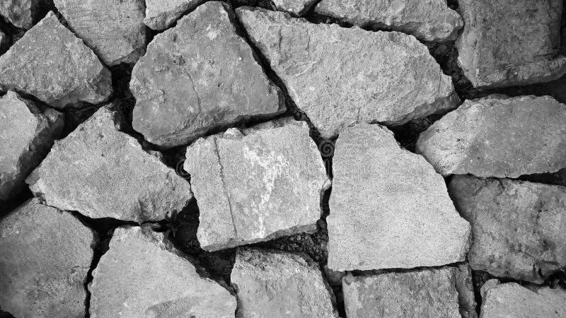 Cor cinzenta do teste padrão do sumário da superfície de pedra real rachada desigual decorativa do assoalho do projeto moderno do imagem de stock