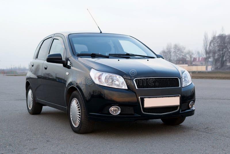 Cor compacta modelo nova do preto do portal do carro moderno fotos de stock