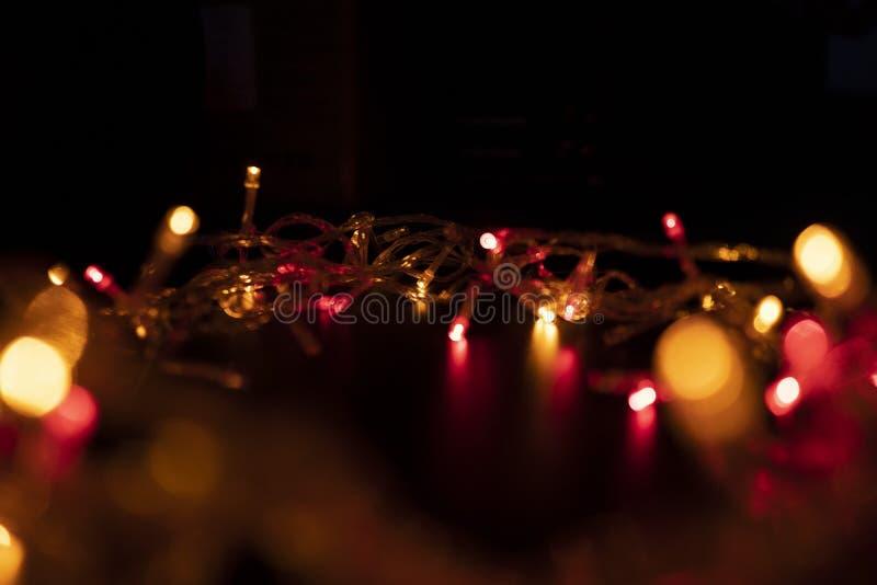 A cor da luz pisca alaranjada sob a forma de Bokeh fotografia de stock