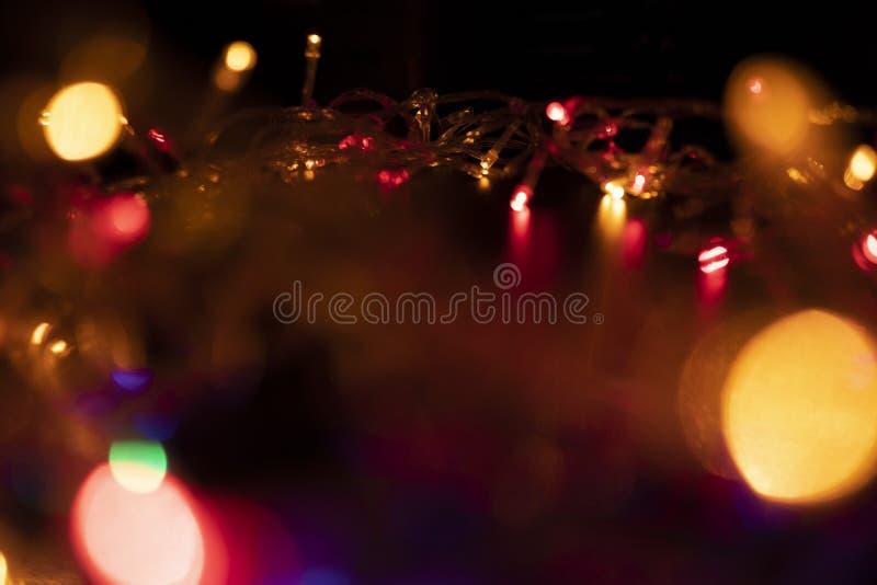 A cor da luz pisca alaranjada sob a forma de Bokeh fotografia de stock royalty free
