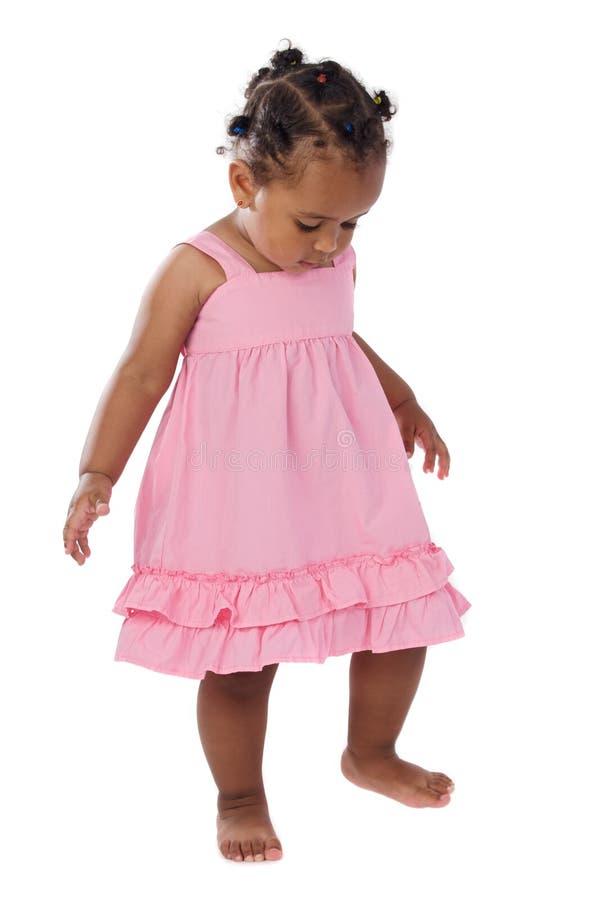 Cor-de-rosa de bebê adorável vestida fotos de stock