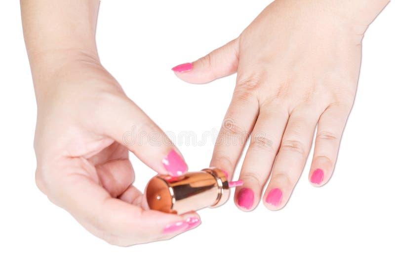 Cor do rosa da pintura do prego do tratamento de mãos foto de stock